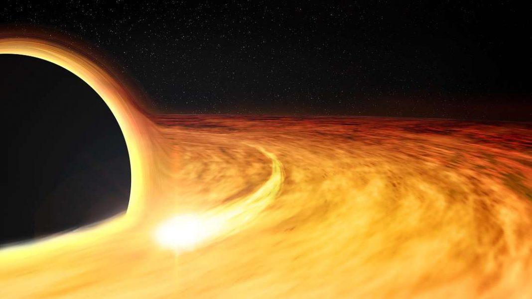 Este agujero negro supermasivo gira al 50 por ciento la velocidad de la luz