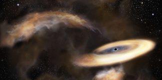 Representación artística de una nube de gas girando alrededor de un agujero negro